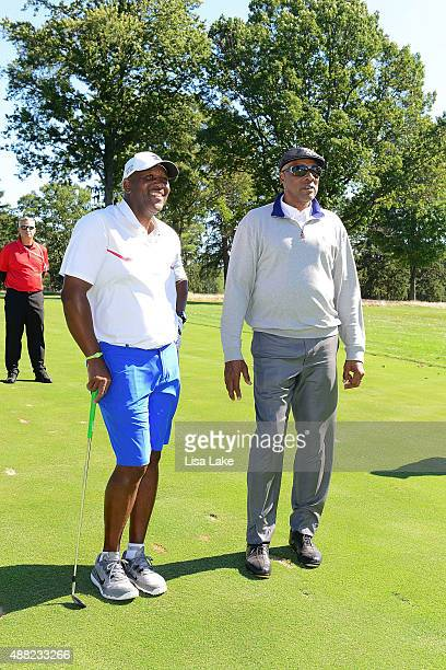Former baseball player Joe Carter with Julius Erving at the Julius Erving Golf Classic at Aronimink Golf Club on September 14 2015 in Newtown...