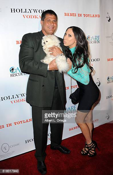Former Baseball player Jose Conseco with dog Chloe and model Leila Knight arrive for the 2nd Annual Babes In Toyland Pet Edition held at Avalon on...
