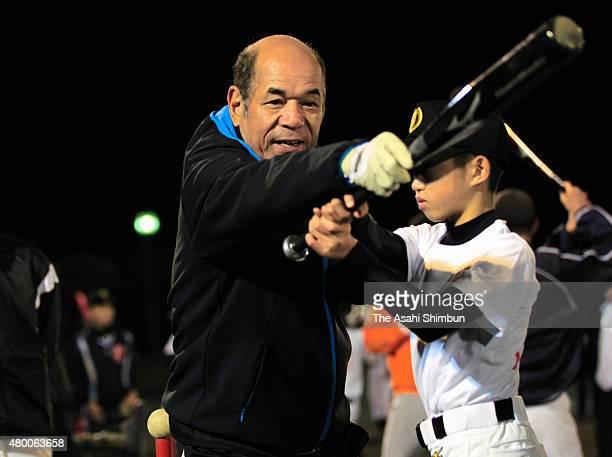 Former baseball player Sachio Kinugasa instructs during the baseball lesson held with Cal Ripken at the tsunami devastated area on November 10 2011...