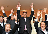 10 Former baseball player turned upper house lawmaker Hiroo Ishii of the Liberal Democratic Party and his supporters make banzai cheers to celebrate...