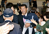 10 Former baseball player turned upper house lawmaker Hiroo Ishii of the Liberal Democratic Party celebrates winning the second term at his election...