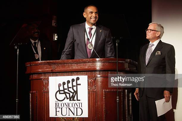 Former basketball player Grant Hill and journalist Tom Brokaw speak onstage at the 29th Annual Great Sports Legends Dinner to benefit The Buoniconti...