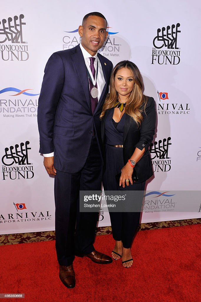 Former basketball player <a gi-track='captionPersonalityLinkClicked' href=/galleries/search?phrase=Grant+Hill+-+Basketball+Player&family=editorial&specificpeople=201658 ng-click='$event.stopPropagation()'>Grant Hill</a> (L) and <a gi-track='captionPersonalityLinkClicked' href=/galleries/search?phrase=Tamia&family=editorial&specificpeople=216487 ng-click='$event.stopPropagation()'>Tamia</a> attend the 29th Annual Great Sports Legends Dinner to benefit The Buoniconti Fund to Cure Paralysis at The Waldorf Astoria on September 29, 2014 in New York City.
