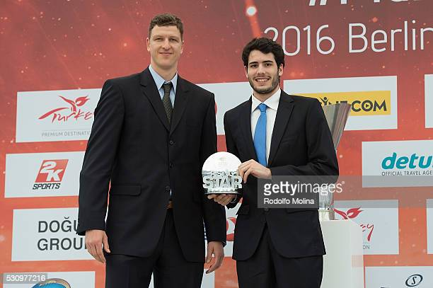 Former basketball player Patrick Femerling gives Alex Abrines #10 of FC Barcelona Lassa the Rising Star Trophy during Turkish Airlines Euroleague...
