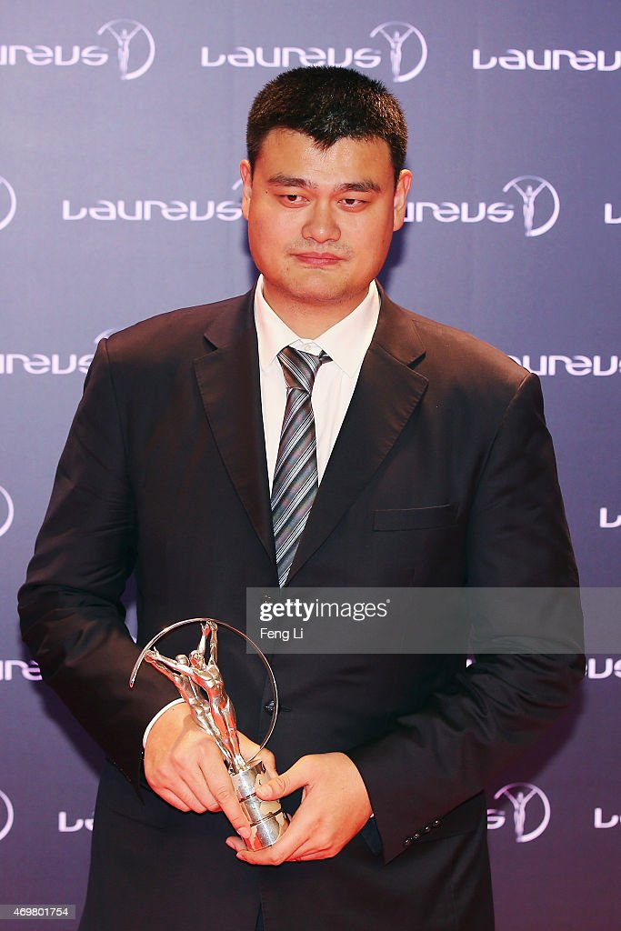 Former Basketball player <a gi-track='captionPersonalityLinkClicked' href=/galleries/search?phrase=Yao+Ming&family=editorial&specificpeople=201476 ng-click='$event.stopPropagation()'>Yao Ming</a> of China with his Laureus Spirit of Sport award at the winners photocall during the 2015 Laureus World Sports Awards at the Shanghai Grand Theatre on April 15, 2015 in Shanghai, China.