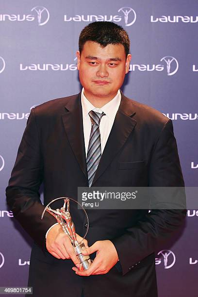 Former Basketball player Yao Ming of China with his Laureus Spirit of Sport award at the winners photocall during the 2015 Laureus World Sports...