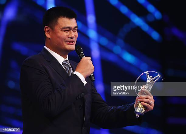 Former Basketball player Yao Ming of China with his Laureus Spirit of Sport award speaks onstage during the 2015 Laureus World Sports Awards show at...