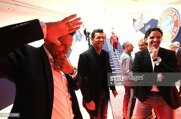 Former Bayern Muenchen players Hasan Salihamidzic Michael Ballack and Owen Hargreaves smile at the player's tunnel ahead of the Bundesliga match FC...