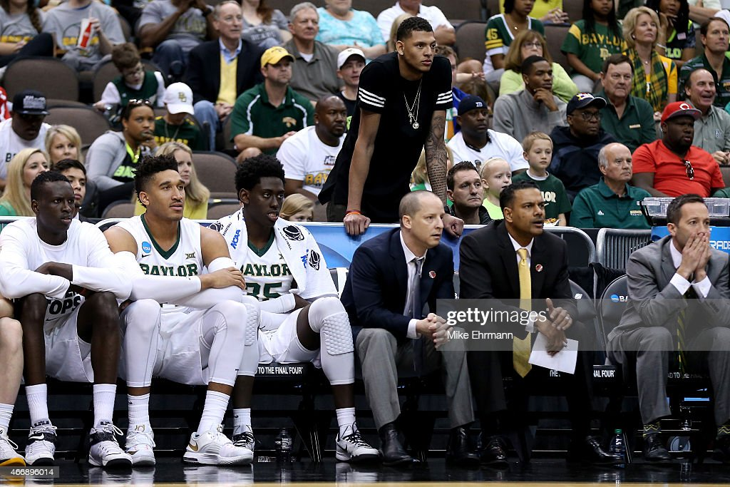 Former Baylor Bears star Isaiah Austin watches from behind the bench as the Bears take on the Georgia State Panthers during the second round of the...