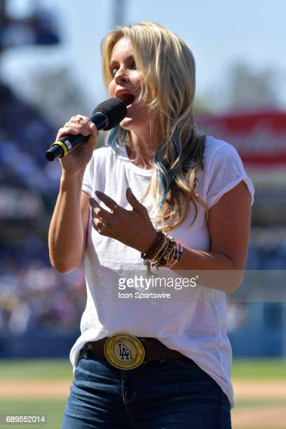 Former Baywatch actress Kelly Packard sings 'God Bless America' during an MLB game between the Chicago Cubs and the Los Angeles Dodgers on May 28 at...