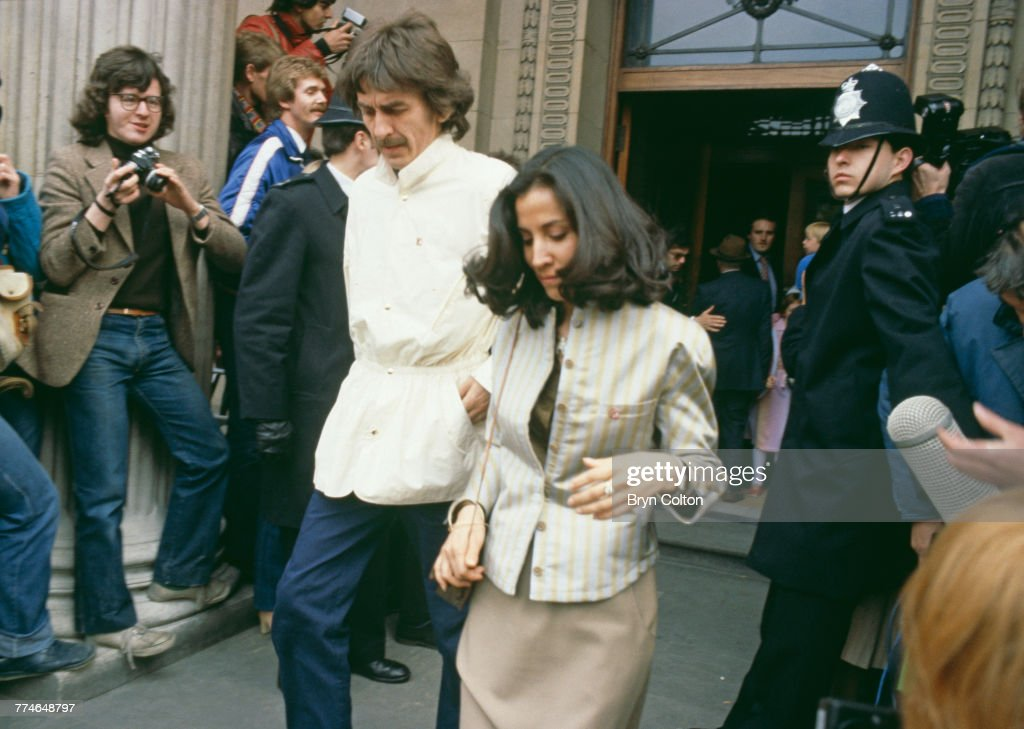 Former Beatle George Harrison and his wife Olivia Harrison, leaving Marylebone Register Office after the wedding ceremony of fellow Beatle Ringo Starr and American actress Barbara Bach, London, April 27, 1981.