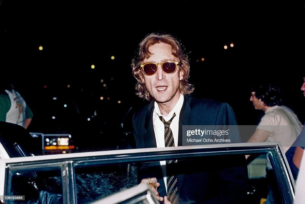 Former Beatle <a gi-track='captionPersonalityLinkClicked' href=/galleries/search?phrase=John+Lennon&family=editorial&specificpeople=91242 ng-click='$event.stopPropagation()'>John Lennon</a> arrives at the Times Square recording studio 'The Hit Factory' before a recording session of his final album 'Double Fanasy' in August 1980 in New York City, New York.
