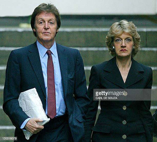 Former Beatle Paul McCartney and his lawyer Fiona Shackleton are pictured at the High Court in London on February 13 2008 McCartney and his estranged...