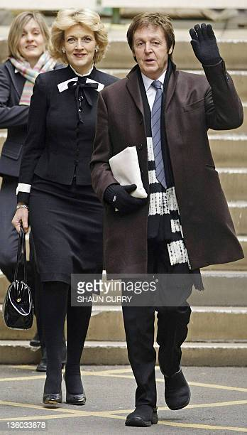 Former Beatle Sir Paul McCartney arrives at London's High Court on March 17 with his legal representative Fiona Shackleton A judge will on Monday...