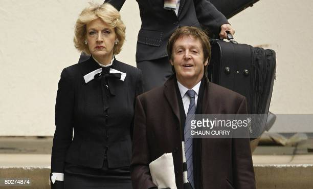 Former Beatle Sir Paul McCartney arrives at London's High Court on March 17 with his legal representative Fiona Shackleton Pop legend Paul McCartney...