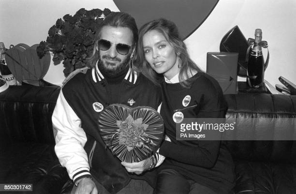 Former Beatles drummer Ringo Starr and his actress wife Barbara Bach share a Valentine's Day heart in a Bond Street shop in London where the couple...
