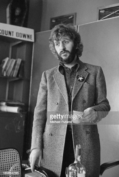 Former Beatles drummer Ringo Starr wearing a badge with his name and a star motif 22nd October 1973