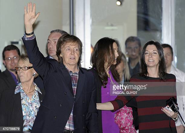 Former Beatles Paul McCartney along with his wife Nancy Shevell and his daughter Mary waves as he leaves the Pavillon Populaire venue in Montpellier...