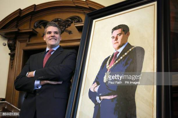 Former Belfast Lord Mayor Gavin Robinson at the unveiling of his portrait by artist Ross Wilson at City Hall in Belfast