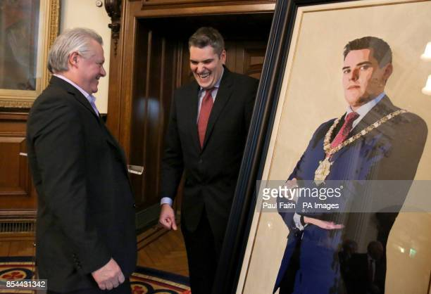 Former Belfast Lord Mayor Gavin Robinson speaks to artist Ross Wilson at the unveiling of his portrait at City Hall in Belfast