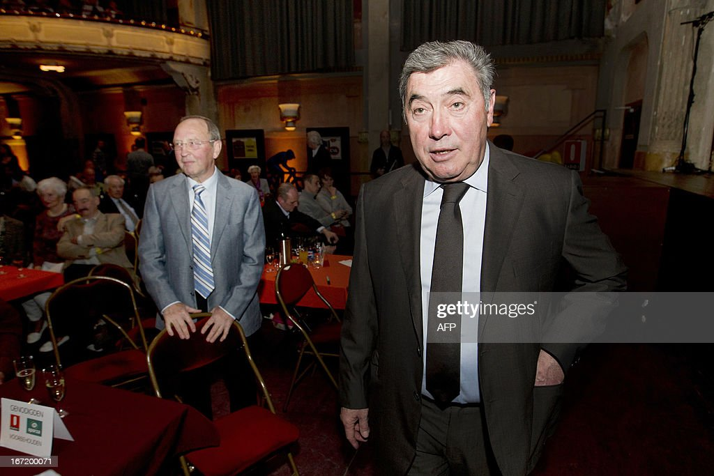 Former Belgian cyclist Walter Godefroot (C) and Belgian cycling legend Eddy Merckx are pictured prior to attend the 'Sporza Merckx' event organized by Radio 1 and Sporza, in honor of Merckx and the 100th Tour de France, on April 22, 2013 at De Roma in Borgerhout in Antwerp.