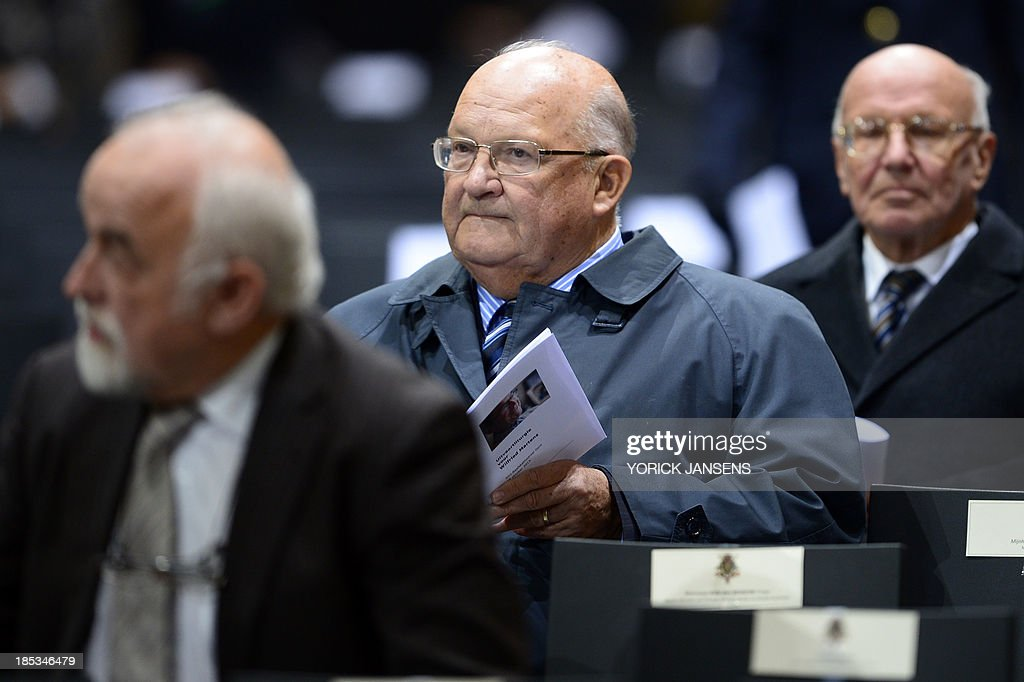 Former Belgian Prime Minister <a gi-track='captionPersonalityLinkClicked' href=/galleries/search?phrase=Jean-Luc+Dehaene&family=editorial&specificpeople=2586798 ng-click='$event.stopPropagation()'>Jean-Luc Dehaene</a> (C) looks on before the funeral ceremony of Belgian Minister of State Wilfried Martens on October 19, 2013 in Saint Bavo's Cathedral (Sint-Baafskathedraal - Cathedrale Saint Bavon) in Gent. 77-years-old Martens had a long career in national and international politics, he was Prime Minister in 9 Belgian Federal governments, and served as President of the European People's Party (EPP) which he co-founded.