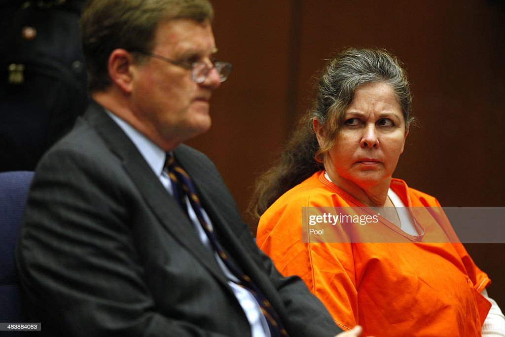 Former Bell assistant city administrator Angela Spaccia looks toward her attorney Harland Braun during her sentencing hearing April 10, 2014 in Los Angeles, California. Spaccia was sentenced to 11 years and eight months in prison for bilking the city's coffers of thousands of dollars through an exorbitant salary and a pair of six-figure loans of taxpayer money. Los Angeles Superior Court Judge Kathleen Kennedy called Spaccia a 'con artist'' during the sentencing hearing, rejecting Spaccia's claim that she was a victim of former Bell administrator Robert Rizzo. The sentencing came one day after five former Bell city officials accepted plea deals that will cap their prison terms at four years.
