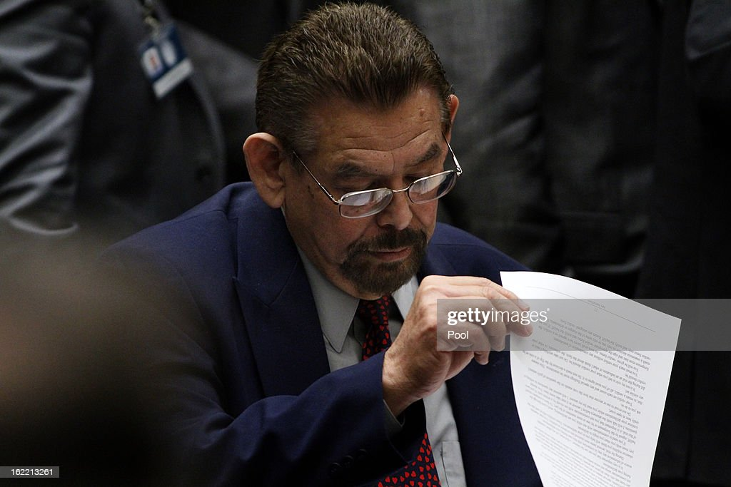 Former Bell council member George Mirabal, who is charged with misappropriation of public funds, looks over some documents on the opening day of closing arguments session on February 20, 2013 in Los Angeles, California. Six former city officials are charged with misappropriating public funds and, if convicted, can spend 12 to 21 years in prison.