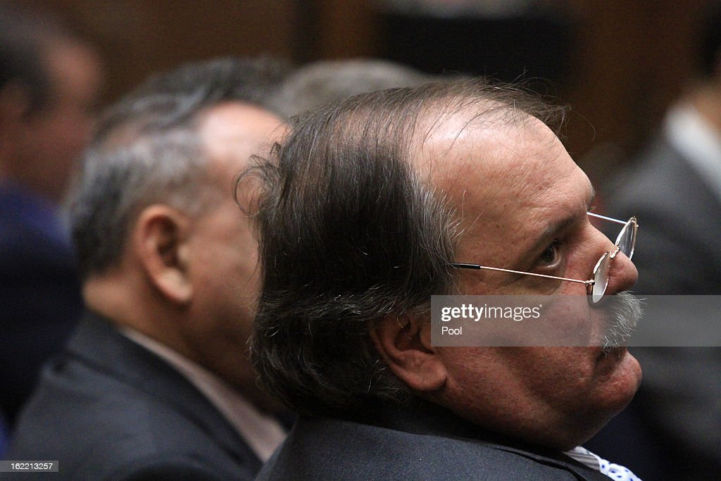Former Bell council member Victor Bello, who is charged with misappropriation of public funds, listens to closing arguments presented by Deputy Dist. Atty. Edward Miller on February 20, 2013 in Los Angeles, California. Six former city officials are charged with misappropriating public funds and, if convicted, can spend 12 to 21 years in prison.