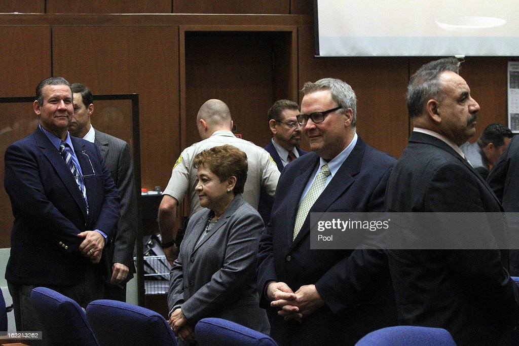 Former Bell council members Luis Artiga, left, Teresa Jacobo, George Mirabal, George Cole and former Mayor Oscar Hernandez stand in respect of jury as closing arguments session breaks for lunch on February 20, 2013 in Los Angeles, California. Six former city officials are charged with misappropriating public funds and, if convicted, can spend 12 to 21 years in prison.