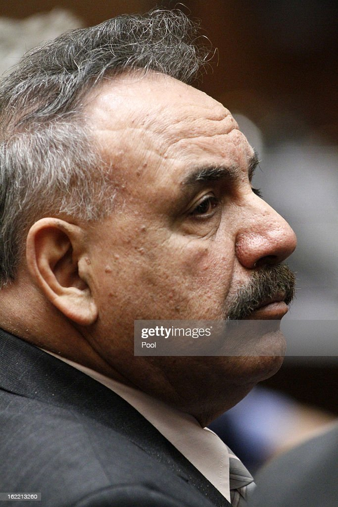 Former Bell Mayor Oscar Hernandez, who is charged with misappropriation of public funds, listens to closing arguments presented by Deputy Dist. Atty. Edward Miller on February 20, 2013 in Los Angeles, California. Six former city officials are charged with misappropriating public funds and, if convicted, can spend 12 to 21 years in prison.