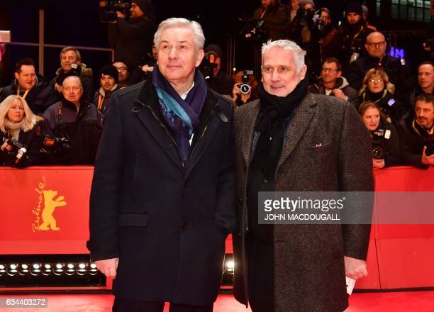 Former Berlin mayor Klaus Wowereit and his partner Joern Kubicki arrive for the opening of the Berlinale film festival with the premiere of 'Django'...
