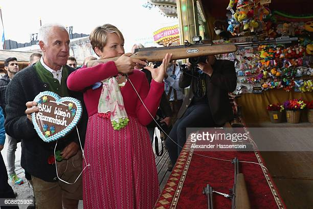 Former Biathlon athlete Magdalena Neuner takes part in a shooting competition with former biathlon athlete Fritz Fischer during the BMW Wiesn...
