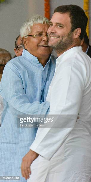 Former Bihar Chief Minister and RJD Chief Lalu Prasad Yadav hugs Congress Vice President Rahul Gandhi during the oath taking ceremony of JDU leader...