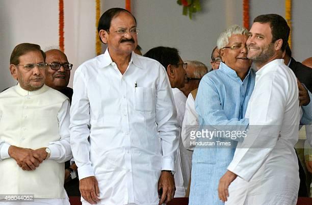 Former Bihar Chief Minister and RJD Chief Lalu Prasad Yadav hugs Congress Vice President Rahul Gandhi as BJP leader Venkaiah Naidu and JDU leader...