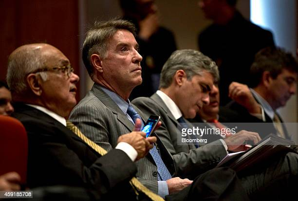 Former billionaire Eike Batista second from left waits inside court for the start of his insidertrading trial in Rio de Janeiro Brazil on Tuesday Nov...