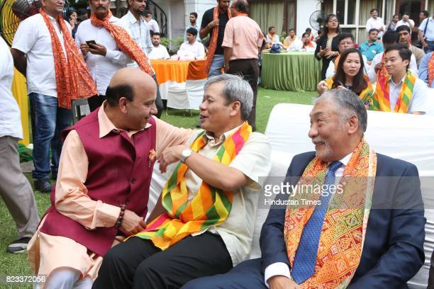 Former BJP MLA Vijay Jolly with Ton Sinh Thanh and Vestop Namgyel during the Teej festival celebrations organised at the residence of Smriti Irani on...