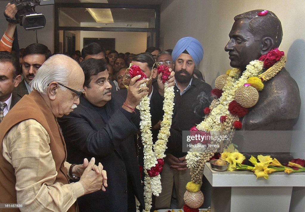 Former BJP President Nitin Gadkari and Lal Krishna Advani senior leader of the Bharatiya Janata Party, pay homage's to statue of Pandit Deendayal death anniversary at BJP HQ on February 11, 2013 in New Delhi, India.