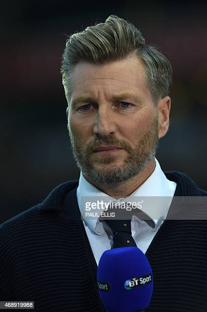 Former Blackburn Rovers player Robbie Savage now a radio and TV pundit broadcasting ahead of the English FA Cup quarterfinal replay football match...