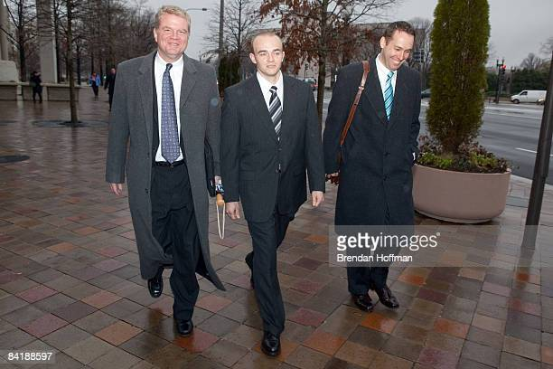 Former Blackwater security guard Nick Slatten and his lawyer Thomas Connolly leave an arraignment hearing at US district court on January 6 2009 in...