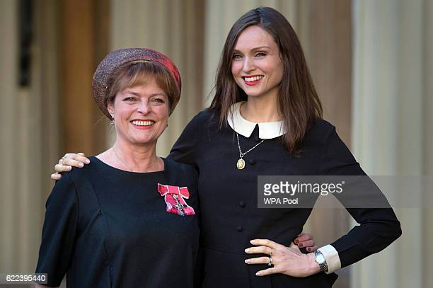 Former Blue Peter presenter Janet Ellis with her daughter Sophie Ellis Bextor after receiving her MBE from the Duke of Cambridge at Buckingham Palace...