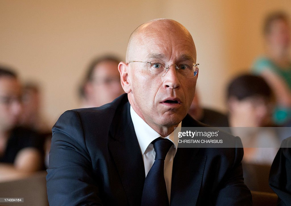 Former board member of HSH Nordbank, Bernhard Visker, appears in court at the beginning of trial against him at the criminal justice department in Hamburg, Germany, on July 24, 2013. Visker and five further bankers allegedly caused a financial damage of 150 million euros in 2007 with risky businesses. AFP PHOTO/ Christian Charisius/ POOL