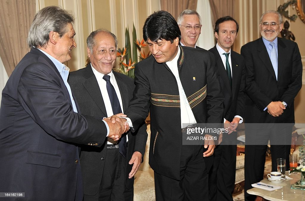 Former Bolivian presidents Jaime Paz Zamora, Guido Vildoso, President Evo Morales and former presidents Eduardo Rodriguez, Jorge Quiroga Ramirez and Carlos Mesa exchange greetins during a meeting to analyse the country's strategy for the claim before Chile for their access to the Pacific Ocean, at the Palacio Quemado presidential palace in La Paz, on March 20, 2013.