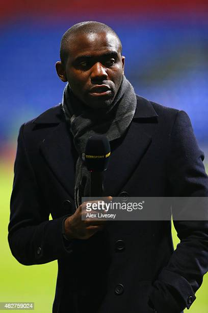 Former Bolton player Fabrice Muamba is interviewed during the FA Cup Fourth round replay between Bolton Wanderers and Liverpool at Macron Stadium on...