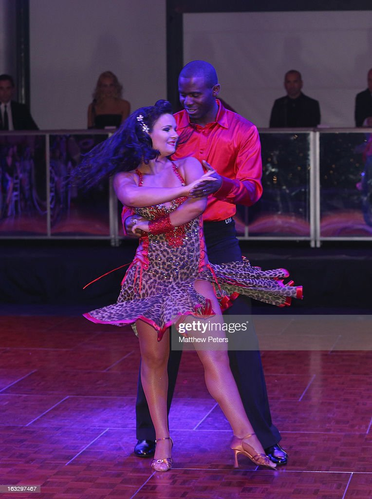 Former Bolton Wanderers player Fabrice Muamba performs a ballroom dancing routine as part of Dancing with United, in aid of the Manchester United Foundation, at Old Trafford on March 7, 2013 in Manchester, England.