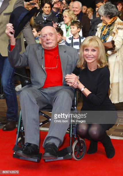 Former Bond Girl Britt Ekland with Lord Montague at a new exhibition Bond in Motion at the National Motor Museum Beaulieu in the New Forest Hampshire