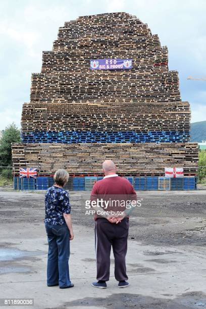 Former Bonfire builder Colin Tweedie inspects a bonfire in the village area of Belfast Northern Ireland on July 10 ahead of the traditional 11th...