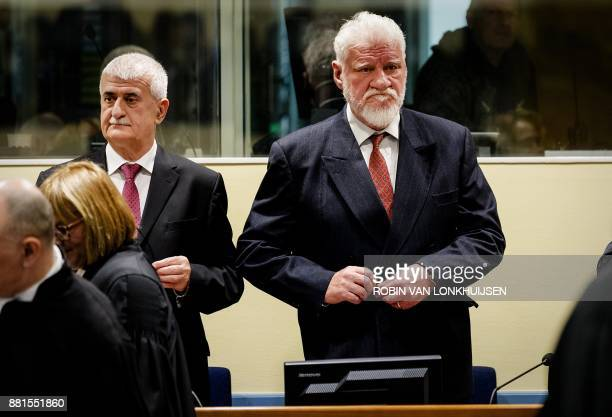 Former Bosnian Croat Defense Minister Bruno Stojic and former Croatian general Slobodan Praljak are pictured prior to the judgement in their appeals...
