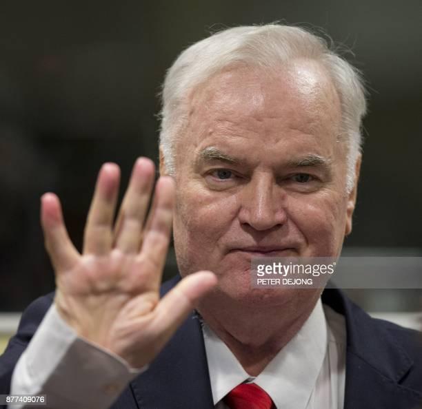 Former Bosnian Serb commander Ratko Mladic waves as he enters the International Criminal Tribunal for the former Yugoslavia on November 22 to hear...