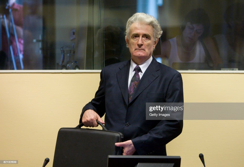 Former Bosnian Serb leader <a gi-track='captionPersonalityLinkClicked' href=/galleries/search?phrase=Radovan+Karadzic&family=editorial&specificpeople=730778 ng-click='$event.stopPropagation()'>Radovan Karadzic</a> makes an initial appearance at the International Criminal Tribunal for the former Yugoslavia (ICTY) on July 31, 2008 in The Hague, The Netherlands. Karadzic was formally charged on 11 counts for war crimes commited during the Bosnian war of the 1990s, following his arrest in Belgrade last week and extradition to the Netherlands after evading capture for 13 years. Karadzic has 30 days to enter a plea.